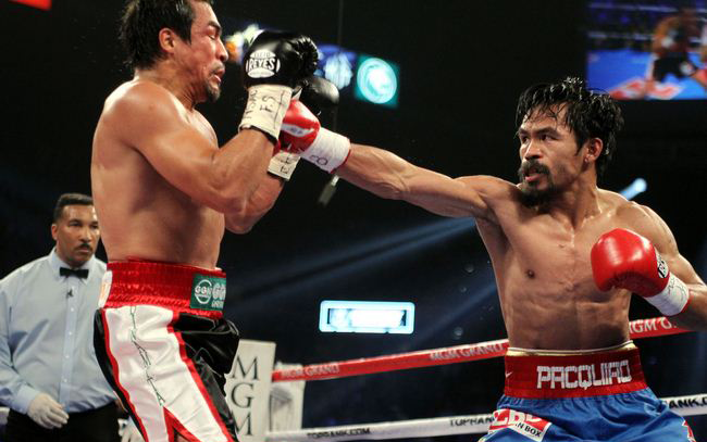 Manny Pacquiao received a brief pep talk from defeated presidential candidate Mitt Romney before going on to lose his match against Juan Manuel Marquez on Saturday.