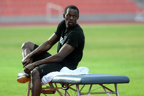 Usain Bolt's agent has dismissed fears that the athlete is suffering from severe back problems in the run up to the London Olympics