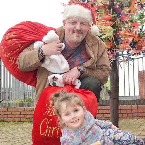 Lottery Winner Becomes Santa for Local Children